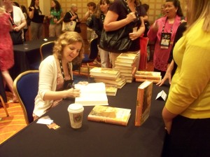 Author Lauren Willig signs at an autographing session.